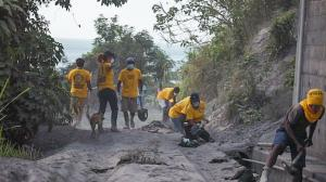 Scientology Volunteer Ministers Disaster Response Team and local volunteers, hard at work cleaning out the drains of Chateaubelair Hospital.