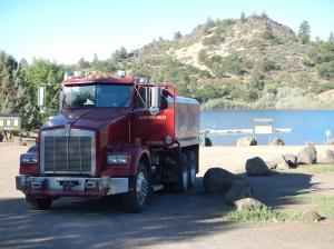 A CAL-FIRE water tanker drafting water from Iron Gate Lake to fight wildfire