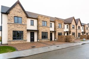 Newly built row of terraced houses for sale in a Residential district on a cloudy winter day