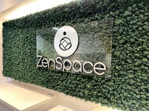 StartUp Remote Work Green Wall Brand Logo Signage ZenSpace Coworking Lounge at Westfield Oakridge Mall