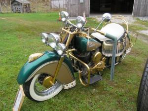 1947 Indian Chief motorcycle, an older restore that's green and gold and with all the stainless-steel parts supposedly dipped in gold (although it has not been tested).