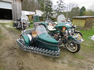 """1976 Harley-Davidson FLH motorcycle with a sidecar that Mr. Bearor dubbed """"The Joker"""". Many hours went into this custom, one-of-a-kind motorcycle."""