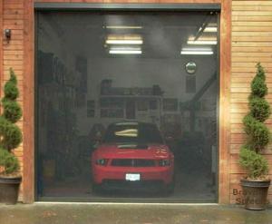 Motorized garage door screen