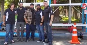 Electro Scan's Dream Team, including Chuck Hansen, Sean Blottie, Jesse Black, John Murdock, and Matt Campos, pictured in front of the company's new outdoor leak detection training facility.