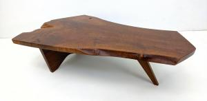 George Nakashima single slab walnut table with one butterfly joint, boasting beautiful grain, 47 inches wide by 28 ½ inches deep. Estimate: $5,000-$8,000.