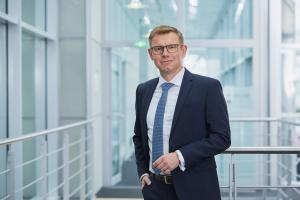 """Uwe Vogt, member of Aucotec board, is proud that Topsoe chose Engineering Base as their new uniform """"data home"""" for the entire engineering and maintenance tasks."""