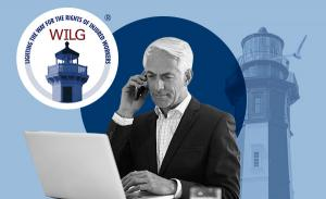 Illustration of a man in a suit, talking on a phone and typing on a laptop with a logo for the Workers' Injury Law & Advocacy Group.