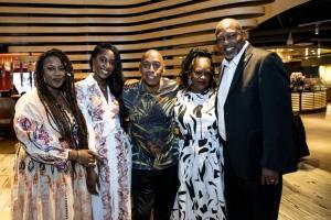 Miami Gardens Mayor Rodney Harris, right, and family meet soul singer Jeffrey Osborne at Embrace Benefit concert.