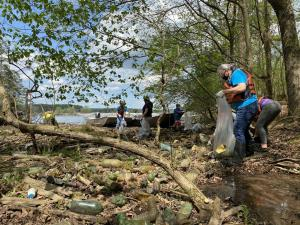 Volunteers collect plastic bottle litter on the Tennessee River in Rogersville, Ala.