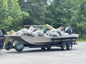 Hauling a boat filled with trash from the Tennessee River