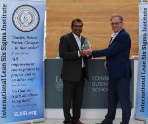 Professor Jiju Antony is handed the ILSSI Lifetime Outstanding Contribution award from Chairman, John Dennis., at the Edinburgh Business School, Scotland.