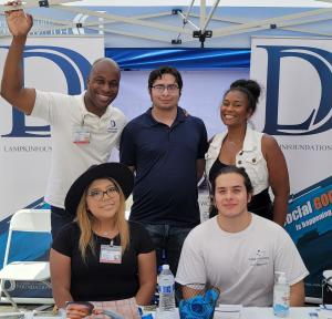Photo of Founder, D'Andre D. Lampkin and Board Member, Tywanna Hill joining volunteers at Ontario Hispanic Chamber of Commerce  Street Festival