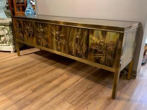 Bernhard Rohne for Mastercraft bronze etched credenza with a brass panel top over three pair of hinged doors ($5,228).