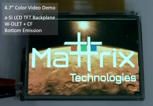 Close up image of Mattrix's AMOLED display prototype and driver electronics displaying an image of the Mattrix logo superimposed on a colorful moonscape