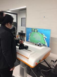 A patient training with the ArmMotus™ M2 at the student-led clinic