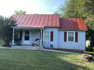 Solid 2 BR/1 BA home on .5 +/- acre lot -- 12'x20' workshop w/air compressor & separate electric meter -- Close to downtown Orange & less than 1.5 miles from all schools
