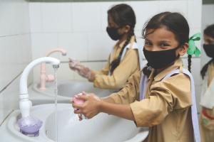 TCF students washing hands, cleanliness guidelines after COVID lockdown