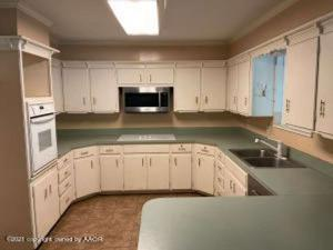 3,479 sq. ft. home with 4 large bedrooms, 2 bathrooms & 2 car garage