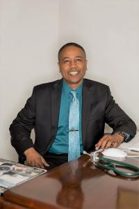 A smiling Dr. Edwards in his office