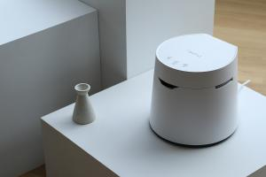 Carepod One humidifier in museum setting on a clean monochrome display