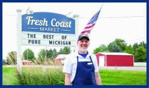 Dave Sears stands outside his store, Fresh Coast Market, in Traverse City, Michigan