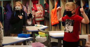 Kids participate in a healthy activity in the classroom