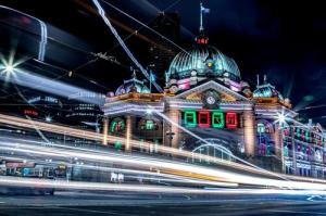 A photograph taken at night of Flinders Street Station in Melbourne