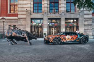 Bugatti Chiron wrapped in tiger stripes, emblazoned with Tiger King Coin and Joe Exotic decals
