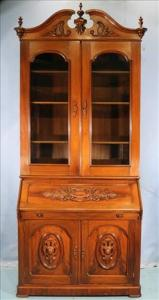 Walnut Victorian slant front secretary desk attributed to Mitchell and Rammelsberg, 8 feet 9 inches tall (estimate: $1,500-$2,500).