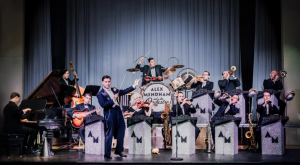Photo of Art Deco Bandleader Alex Mendham and His Orchestra on Stage used to promote 2021 Premiere of Fascinatin Rhythm album by Mendham Guildhawk Song Company