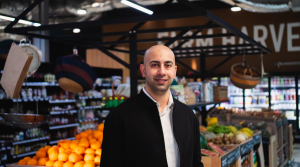 Dr Ali Karami, Founder of NudeHerbs in a grocery store