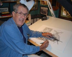 Artist Dick Kramer at the board drawing