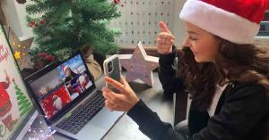 An employee participates in a virtual team building activity for her team's virtual holiday party.