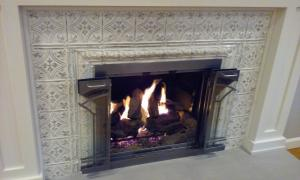 """This 6"""" design in the Ivory Steel finish adds elegant to this fireplace."""
