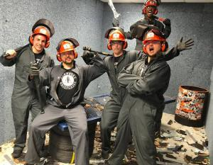 Group having a fun time at Sin City Smash, a rage room in Las Vegas