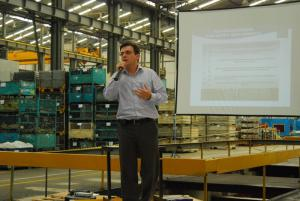 Mr. Eduardo Correa giving a presentation at a manufacturing plant