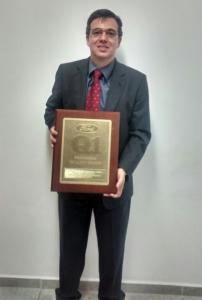 Mr. Eduardo Correa holding the Ford Q1 Award