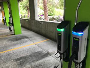 SemaConnect wall-mounted EV charging stations in parking garage