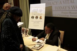 Mr. Ken Morris, signing Frederick Douglass' autobiography, Narrative of the Life of Frederick Douglass, an American Slave