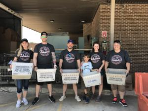 Colleagues and Family Volunteer at Food Drive