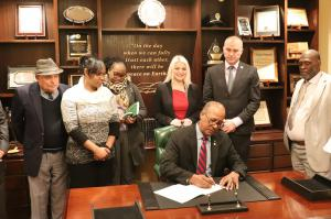 H.E. Sidney Collie, Ambassador of Bahamas to USA and other diplomats signing the Charter of the Commercial Diplomats Club