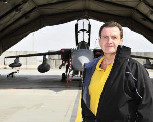 John Nichol by his Tornado aircraft in Afganistan