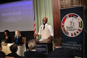 Travis Ellis speaking at one of the events during the three-day U.S. National Human Rights Conference, sponsored by Youth for Human Rights International