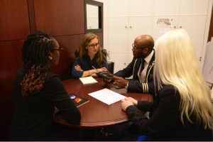 Travis Ellis meeting with Congressional staff on human rights issues that effect youth in his community and the need for education.