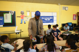 To reduce bullying and prevent violence, Travis Ellis delivers a human rights training at a D.C. elementary school.