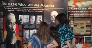 Visitors study one of the displays at the Psychiatry: An Industry of Death Exhibit in Old Sacramento
