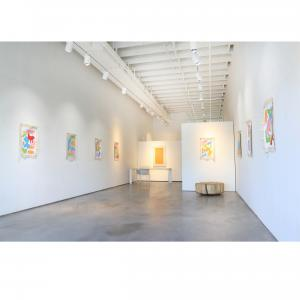 This is an image of Exhibit by Aberson with The Holey Kids work installed for a gallery exhibition. There are brightly colored canvases on the wall.