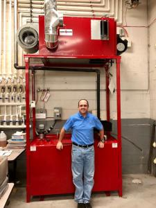 TestOil's Lucian Szokai with Waste Oil Furnace