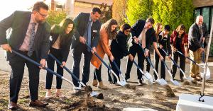 Each using a shovel, the deans, the president, the provost and students of Gonzaga break ground on facility.