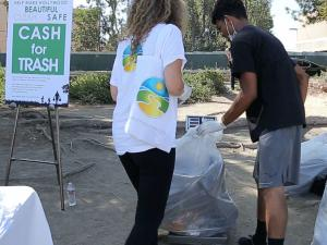 """Weighing the trash at the """"Cash for Trash"""" station"""
